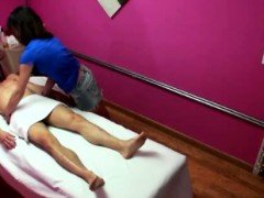 Asian masseur tugs her...